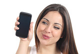 Sweet woman showing a black mobile phone screen 