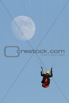 Paragliding with the moon