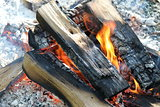 Flame with embers outdoors photo