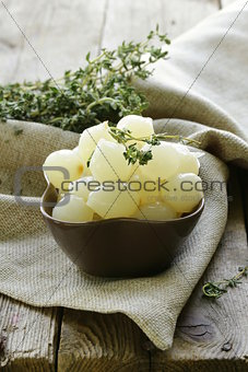 small pickled pearl onions on a wooden table