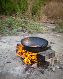 Frying fish in open
