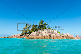 Tropical Island. Calm exotic beach resort in background