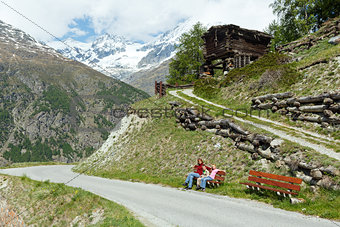 Family  on summer Alps mountain