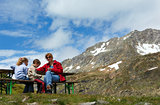 Family  on summer Alps mountain