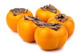 Five ripe persimmon fruits