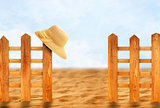Wooden fence and sun hat