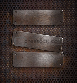 three rusty plates over metal holed or perforated grid backgroun