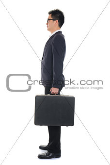 asian business male standing and holding a suitcase ,full body s