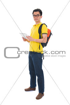 asian male student holding a tab and bag with isolated white bac