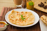 roti canai and teh tarik, very famous drink and food in malaysia