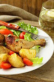 fried chicken with salad and vegetables