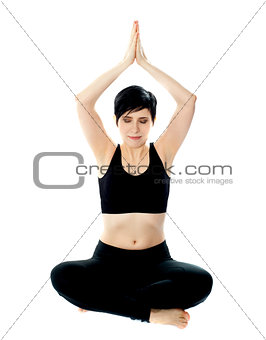 Beautiful blonde girl meditating in black