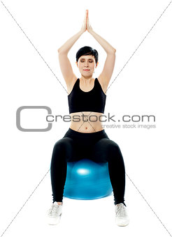 Portrait of a young girl sitting on gymnastic ball