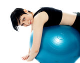 Fitness exercise woman resting on pilates ball