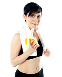 Pretty woman with banana