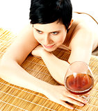 Spa woman relaxing with a wine glass