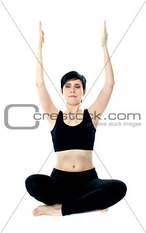 Portrait of beautiful young woman doing yoga exercise