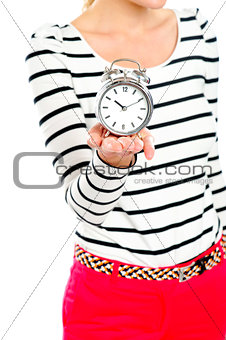 Cropped image of a woman holding alarm clock