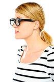 A young beautiful woman wearing sunglasses