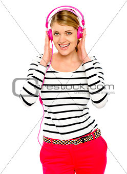 Beautiful electro pop girl enjoying music