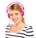 Attractive cheerful woman enjoying music