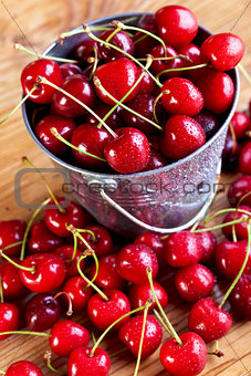 Fresh cherries in a small bucket