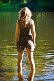 girl stand in river