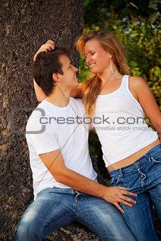 smiling couple next tree