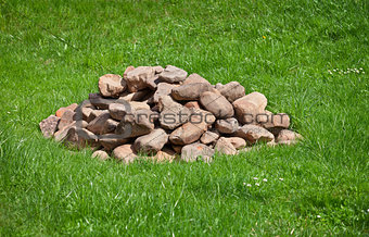 Pile of stones on field