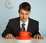 Businessman drinking a very strong and  hot coffee