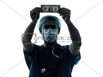doctor surgeon man examing dollar bill silhouette