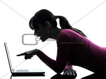 woman mouth open pointing computing laptop computer silhouette