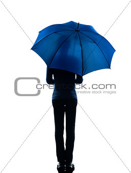 woman rear view holding umbrella silhouette