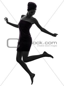 beautiful asian young woman wrapped towel jumping happy silhouet