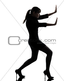 business woman pushing silhouette