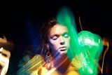 Flutter. Face of Woman in Blurry Colorful Lights. Metamorphose