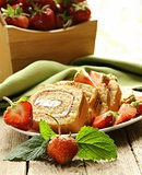 roulade cake with cream and fresh strawberries