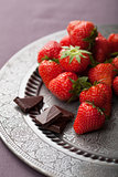strawberry and chocolate on vintage plate