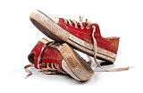 a pair of dirty sneakers isolated on white