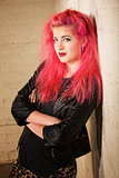 Punk Female Leaning Against Wall