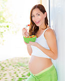 Pregnant female having breakfast