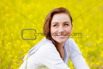 Woman on yellow floral field