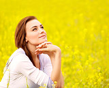 Cute female on yellow floral field