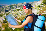 Traveling woman looking in map