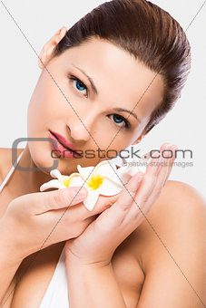Beautiful woman holding flowers