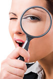 Business holding a magnifying glass