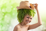 summer girl with hat and grass on head