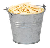 Flaked almonds in a miniature metal bucket