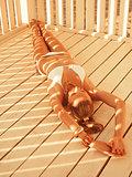 Girl lying in the beach pergola