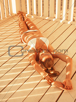 Girl lying in the beach pergola